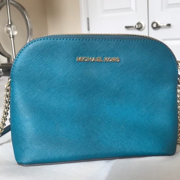 91682045b198 Michael Kors Cindy Dome Crossbody Teal. M_5b8da8dd10fc5474f6e9a289. Other  Bags ...